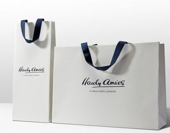 China Reusable Custom Printed Paper Bags With Handles For Packaging White Color supplier