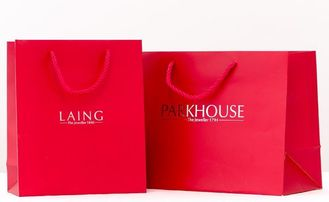 China Red Color Custom Boutique Shopping Bags , Paper Goodie Bags With Logo Print supplier