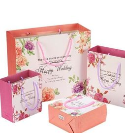China Colored Printed Paper Packaging Bags For Shopping Mall And Retail Stores supplier
