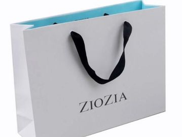 China Decorative Luxury Clothing Paper Bags , White Paper Shopping Bags With Handles supplier