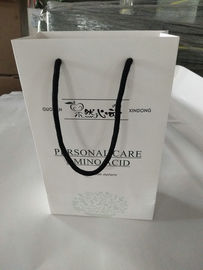 China Promotional Printed Paper Shopping Bags , Printed White Paper Bags With Handles factory